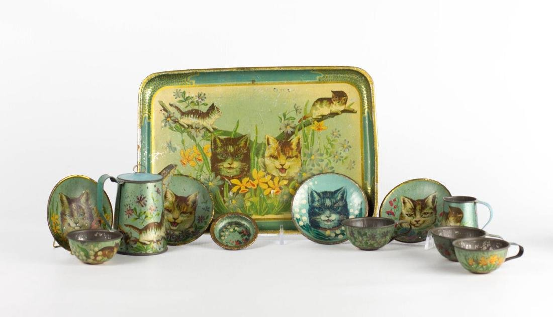A TIN LITHO CHILD'S TEA SET WITH CATS