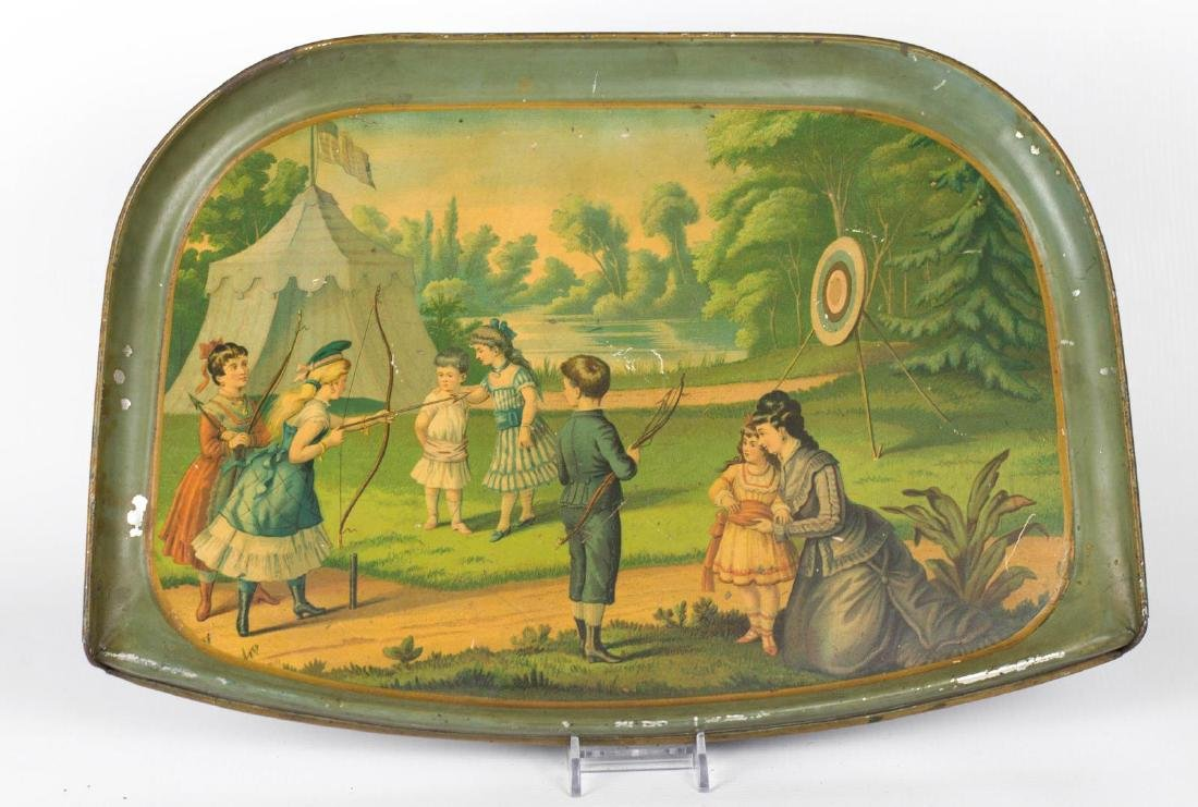 A TIN LITHO HIGH CHAIR TRAY WITH AN ARCHERY SCENE