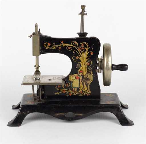 A GERMAN MINIATURE TIN LITHO SEWING MACHINE Fascinating German Sewing Machine