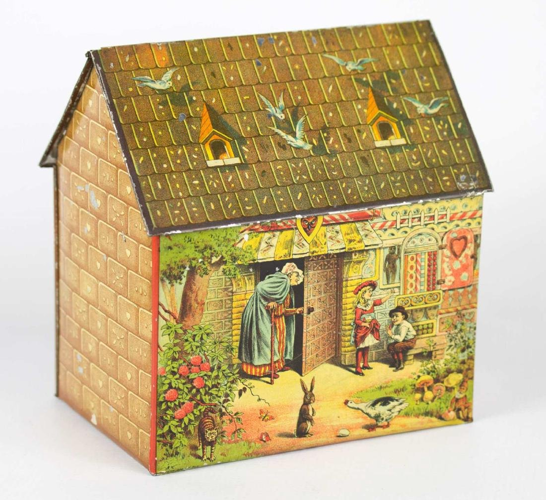 A TIN LITHO HANSEL AND GRETEL BISCUIT TIN