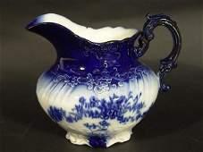 1293: FINE LA BELLE FLOW BLUE MILK PITCHER