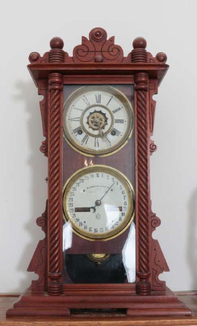 A WATERBURY NO. 40 DOUBLE DIAL CALENDAR CLOCK