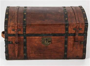 A 19TH CENTURY LEATHER COVERED DOME TOP TRUNK