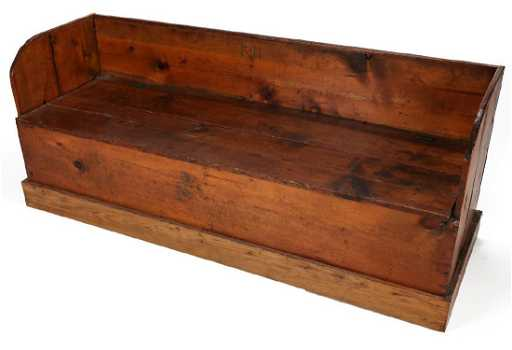 A 19TH CENTURY AMERICAN PINE BENCH WITH LIFT SEAT