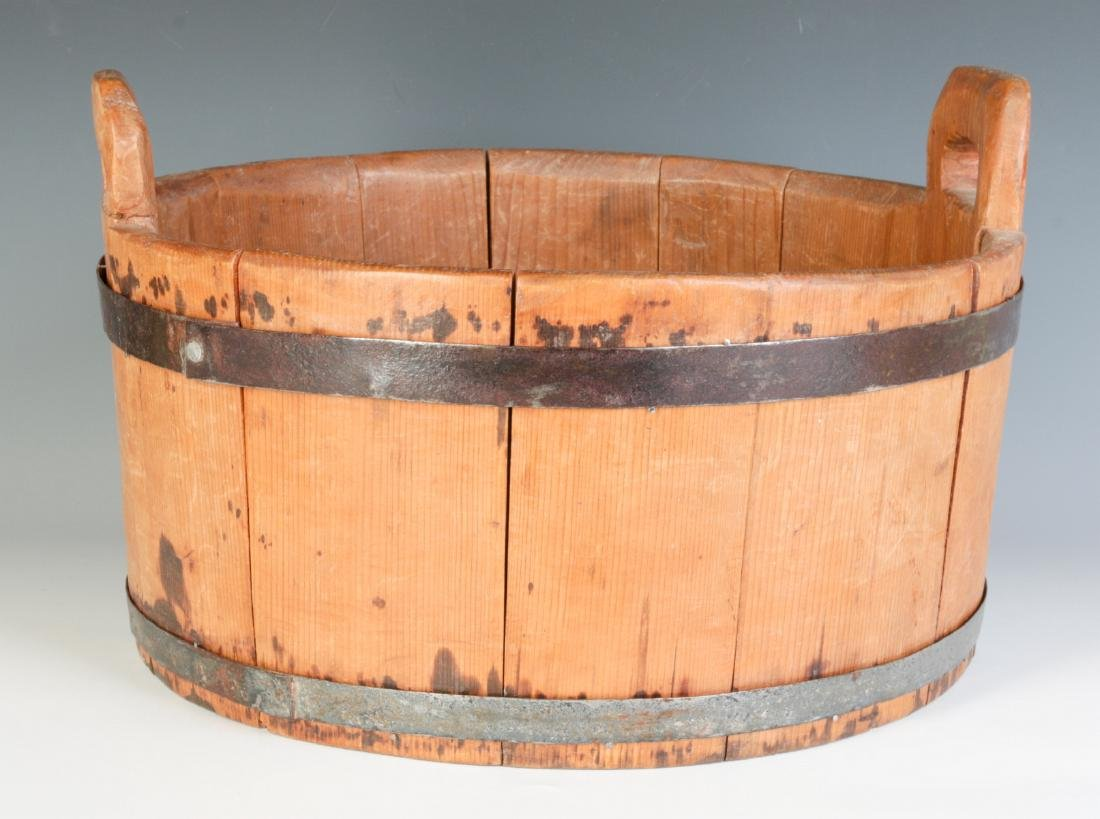 A 19TH CENTURY BUCKET WITH HIGH STAVE HANDLES