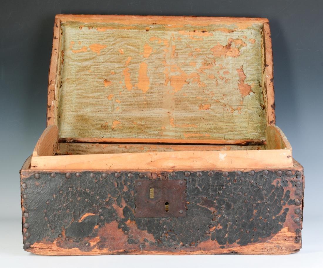 A CIRCA 1800 LEATHER COVERED DOMETOP BOX