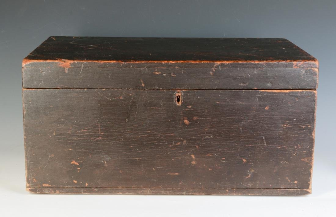A 19TH CENTURY STORAGE BOX IN OLD BROWN PAINT