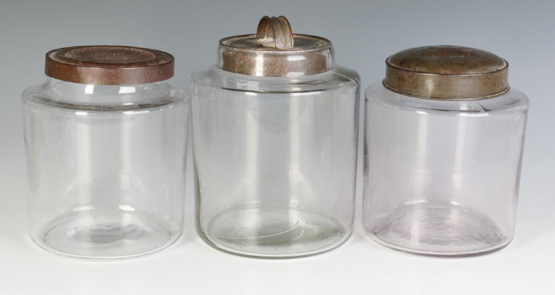 THREE EARLY BLOWN GLASS STORAGE JARS WITH TIN LIDS - 2