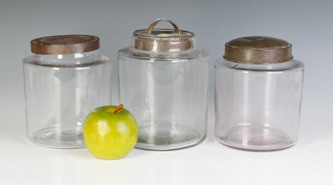 THREE EARLY BLOWN GLASS STORAGE JARS WITH TIN LIDS - 5