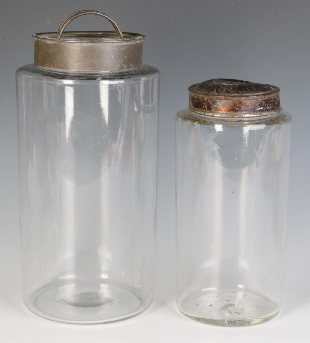 TWO EARLY BLOWN GLASS STORAGE JARS