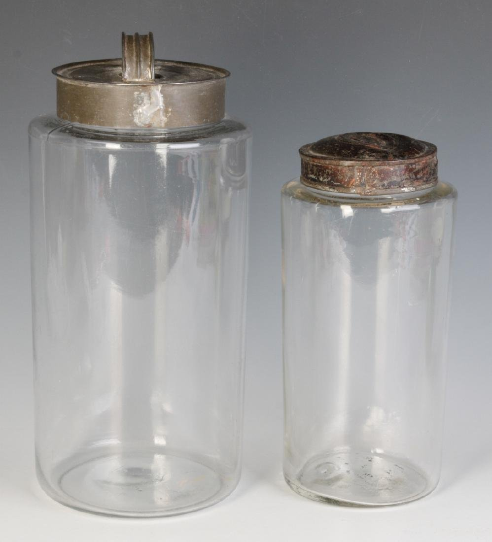 TWO EARLY BLOWN GLASS STORAGE JARS - 2