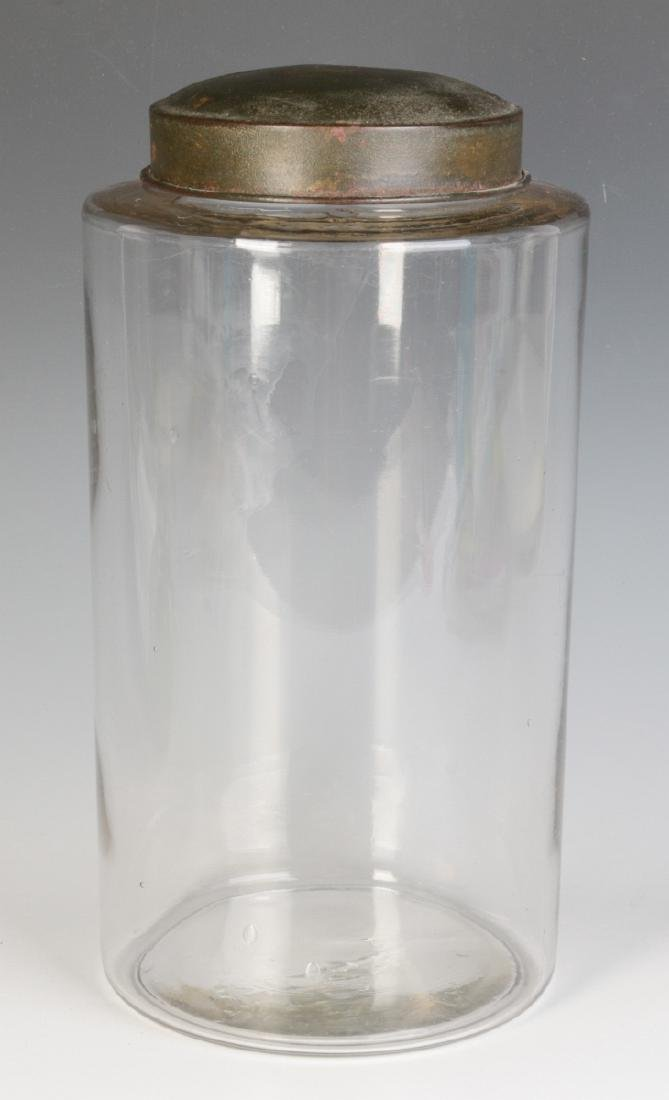 A TALL EARLY BLOWN GLASS STORAGE JAR WITH TOLE LID - 2