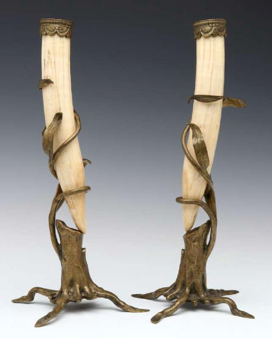 A PAIR OF BRONZE MOUNTED WALRUS TUSK STANDS