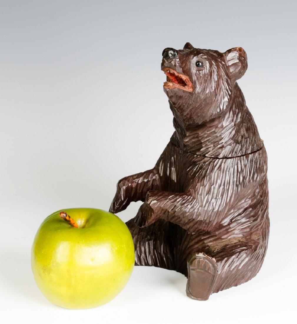 A BLACK FOREST CARVED FIGURAL BEAR CONTAINER - 10