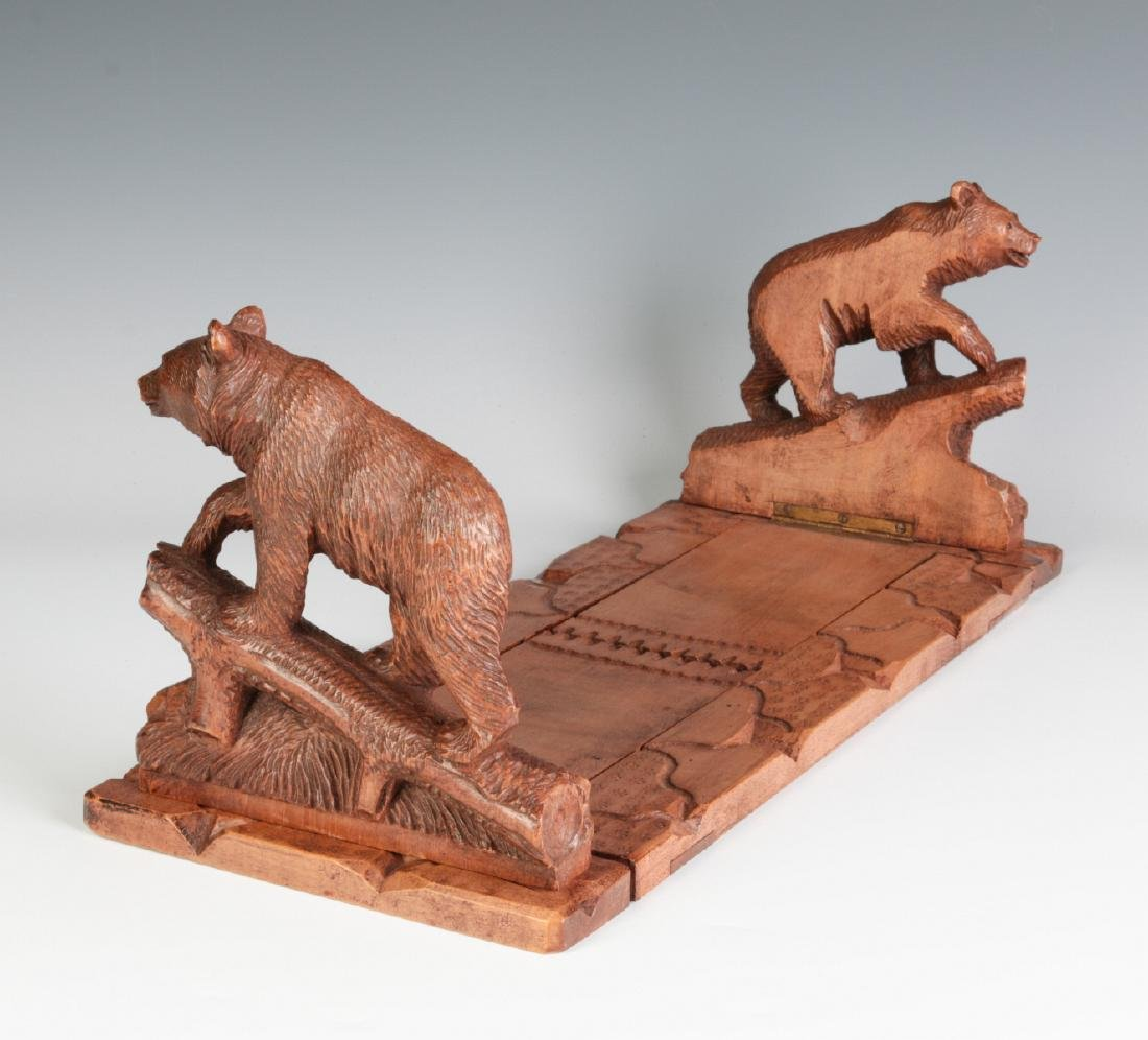 AN EARLY 20TH C BLACK FOREST BOOK STAND WITH BEARS