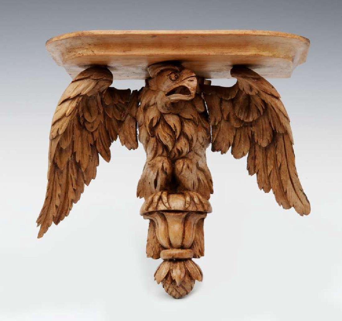 A 19TH C. CARVED PINE FIGURAL EAGLE BRACKET SHELF