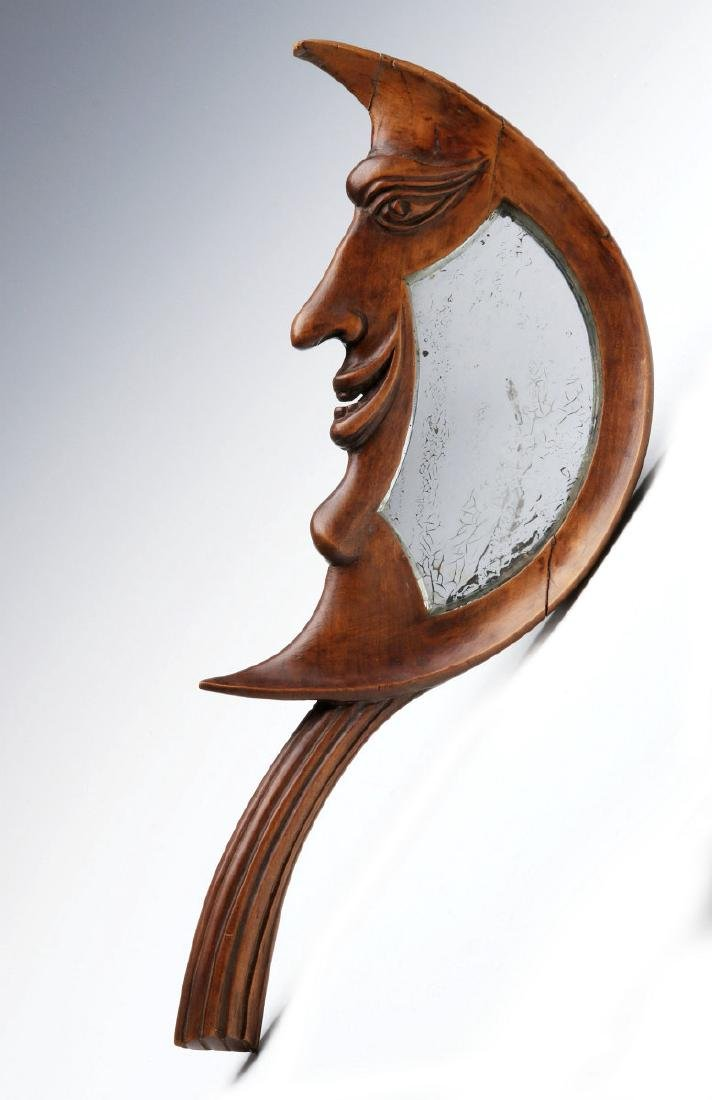 AN EARLY 20TH C. CARVED CRESCENT MOON HAND MIRROR
