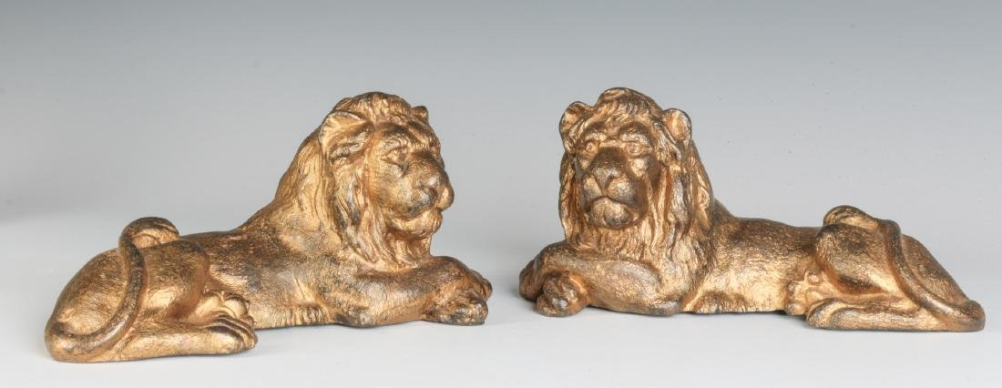 TWO CAST IRON LION FIGURES, OLD GILT PAINT