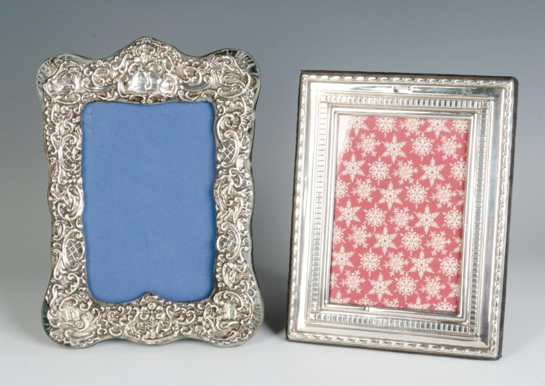 TWO STERLING SILVER EMBELLISHED PICTURE FRAMES