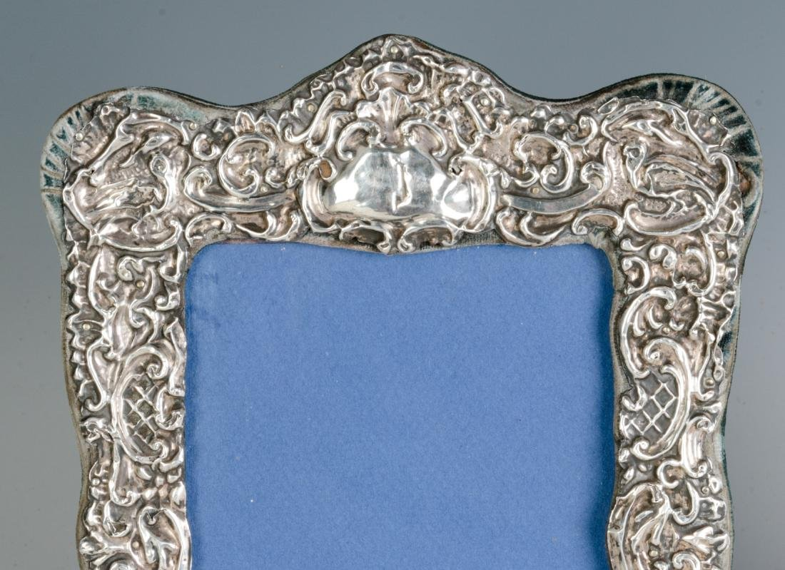TWO STERLING SILVER EMBELLISHED PICTURE FRAMES - 2