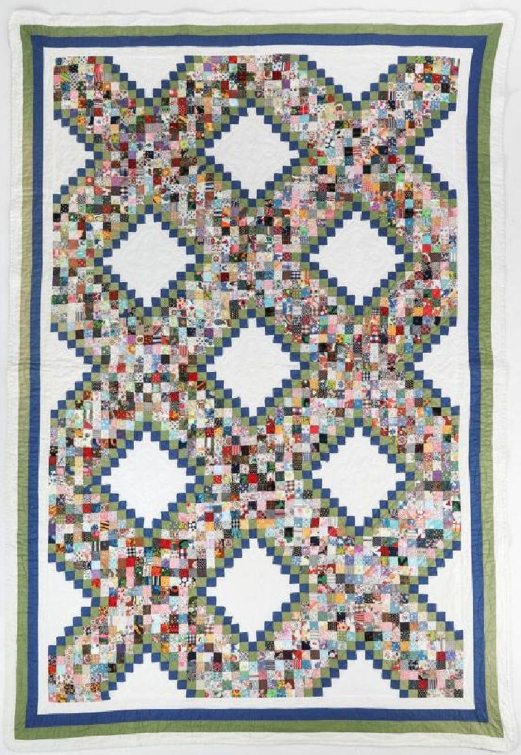 A VINTAGE 'POSTAGE STAMP IRISH CHAIN' QUILT