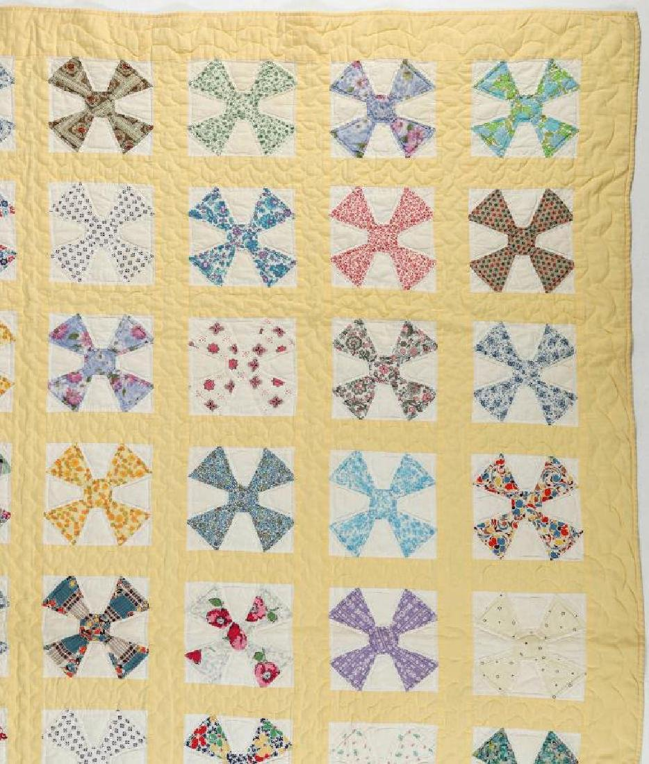 A 1930s 'MALTESE CROSS' FEEDSACK QUILT