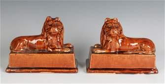 A PAIR BRITISH STONEWARE RECUMBENT LION FIGURES