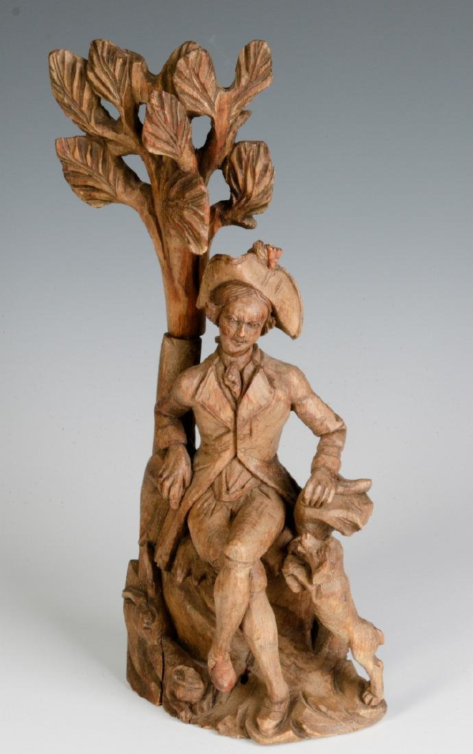AN 18TH C. WOOD CARVING OF A GENTLEMAN AND HIS DOG