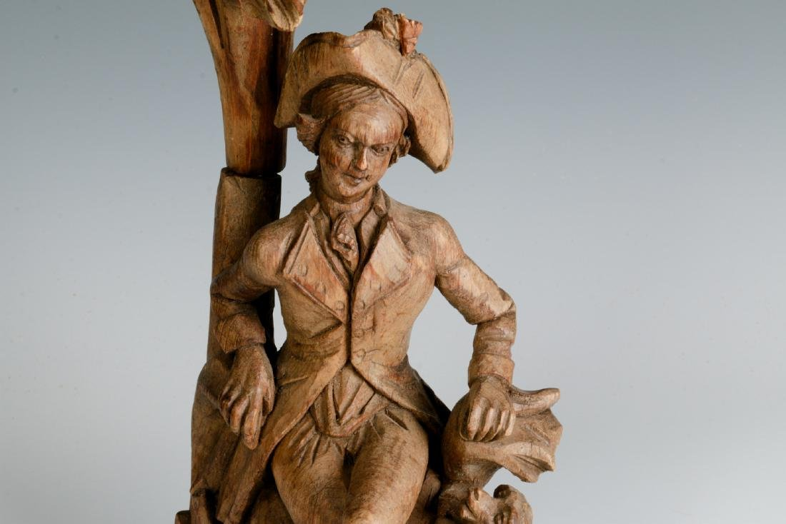 AN 18TH C. WOOD CARVING OF A GENTLEMAN AND HIS DOG - 2