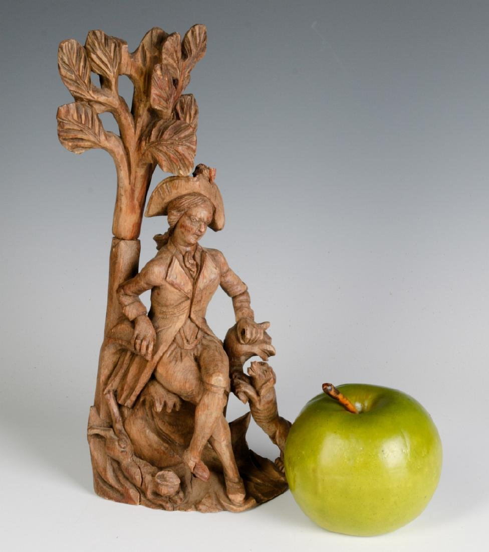AN 18TH C. WOOD CARVING OF A GENTLEMAN AND HIS DOG - 6