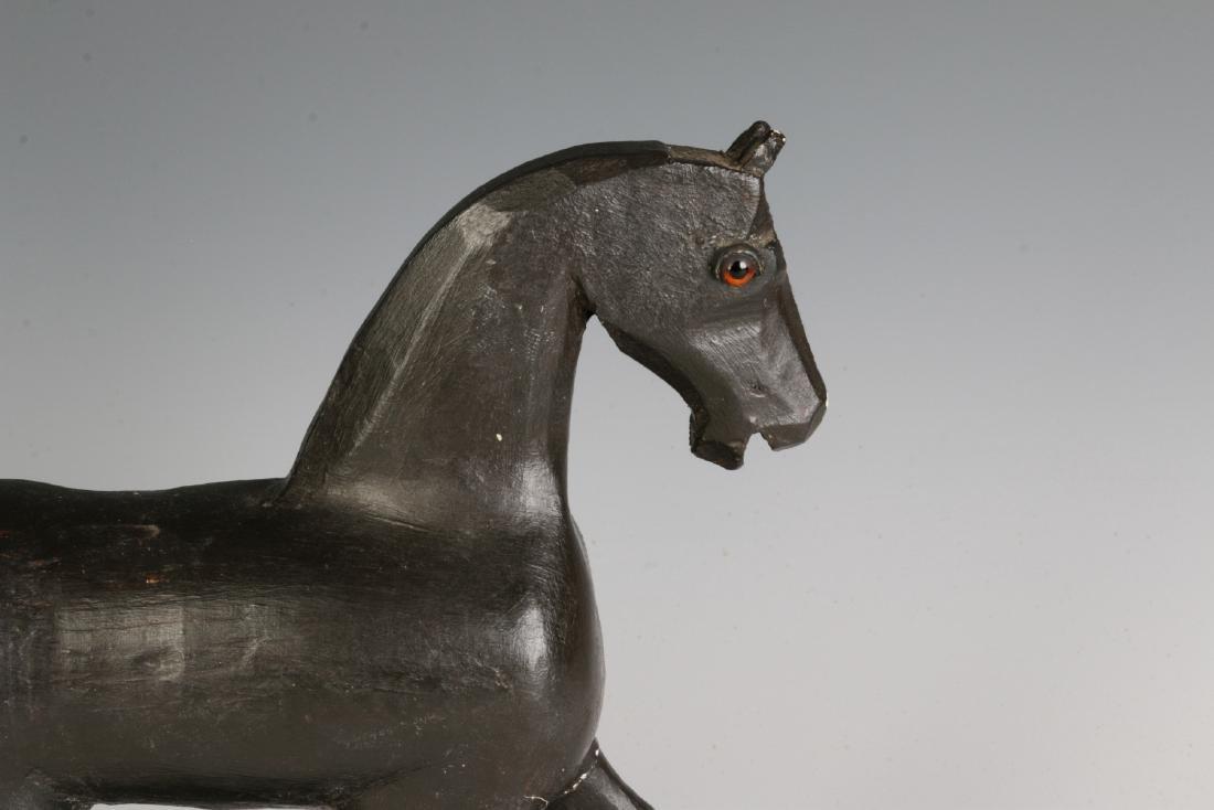 A CIRCA 1900 FOLK ART CARVED WOOD PLATFORM HORSE - 2