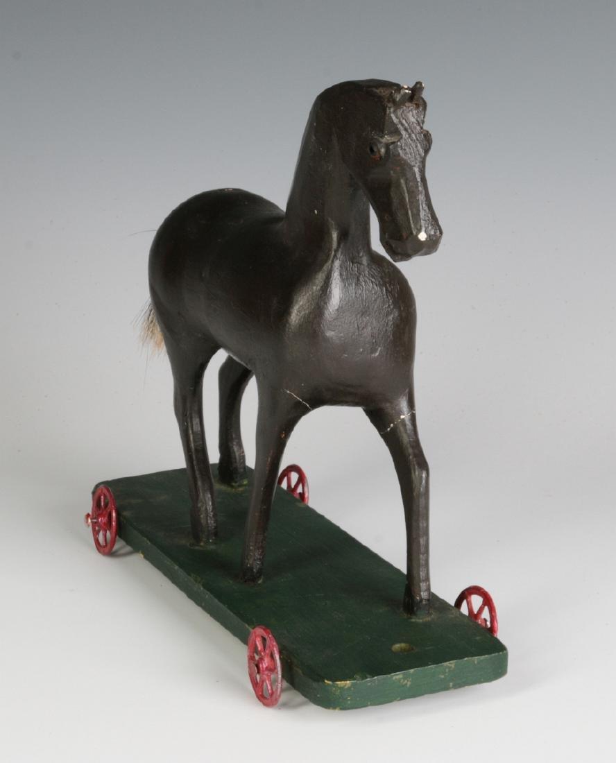 A CIRCA 1900 FOLK ART CARVED WOOD PLATFORM HORSE - 3