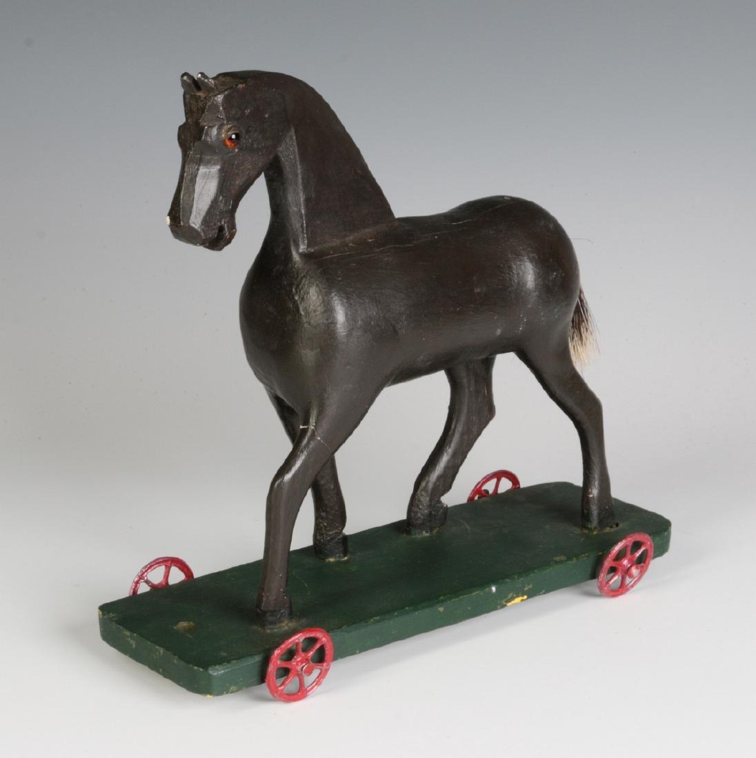 A CIRCA 1900 FOLK ART CARVED WOOD PLATFORM HORSE - 4