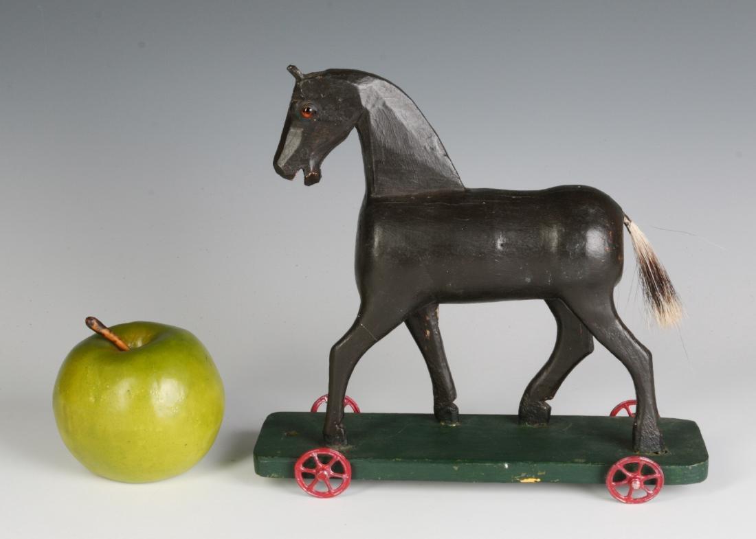 A CIRCA 1900 FOLK ART CARVED WOOD PLATFORM HORSE - 7