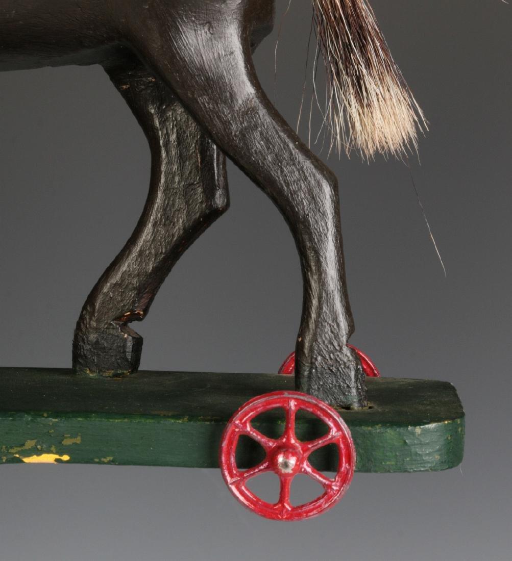 A CIRCA 1900 FOLK ART CARVED WOOD PLATFORM HORSE - 8