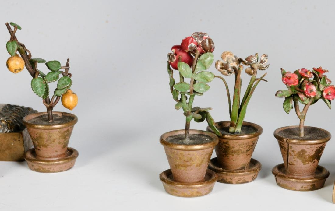 A GROUP OF SMALL EARLY 20THC. CAST BRONZE OBJECTS - 4