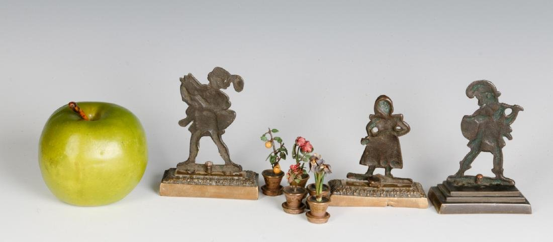 A GROUP OF SMALL EARLY 20THC. CAST BRONZE OBJECTS - 7