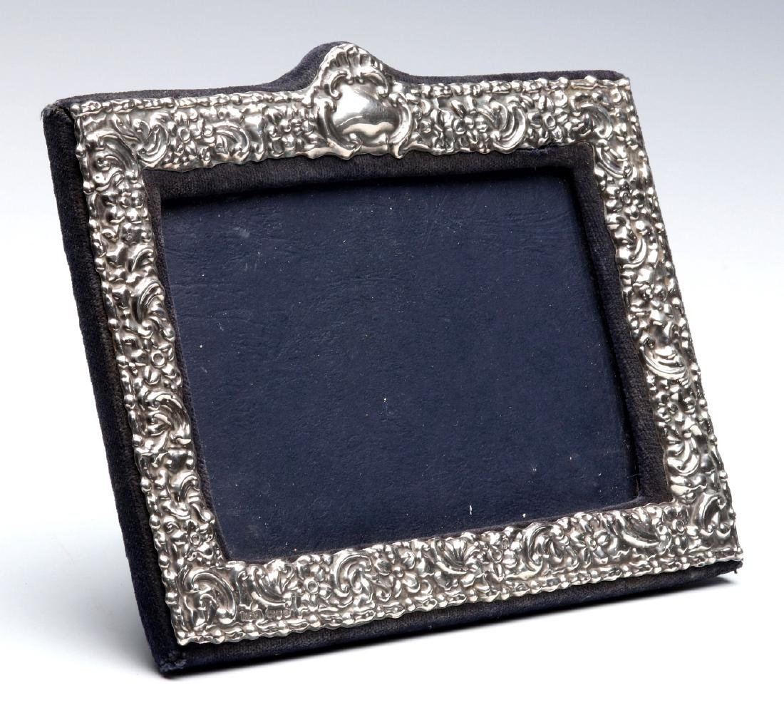 AN EARLY 20TH C.STERLING SILVER REPOUSSE FRAME