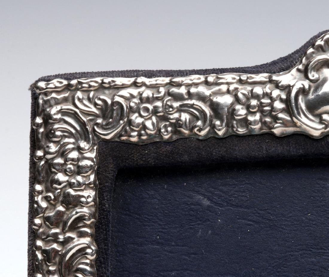 AN EARLY 20TH C.STERLING SILVER REPOUSSE FRAME - 3