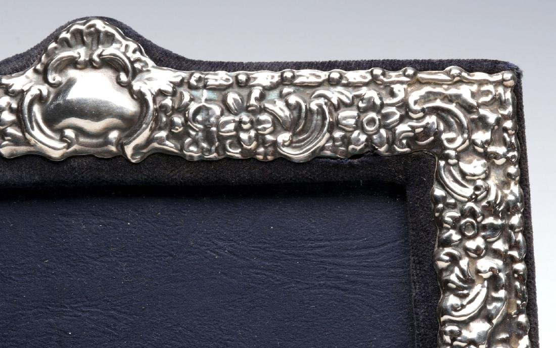 AN EARLY 20TH C.STERLING SILVER REPOUSSE FRAME - 4