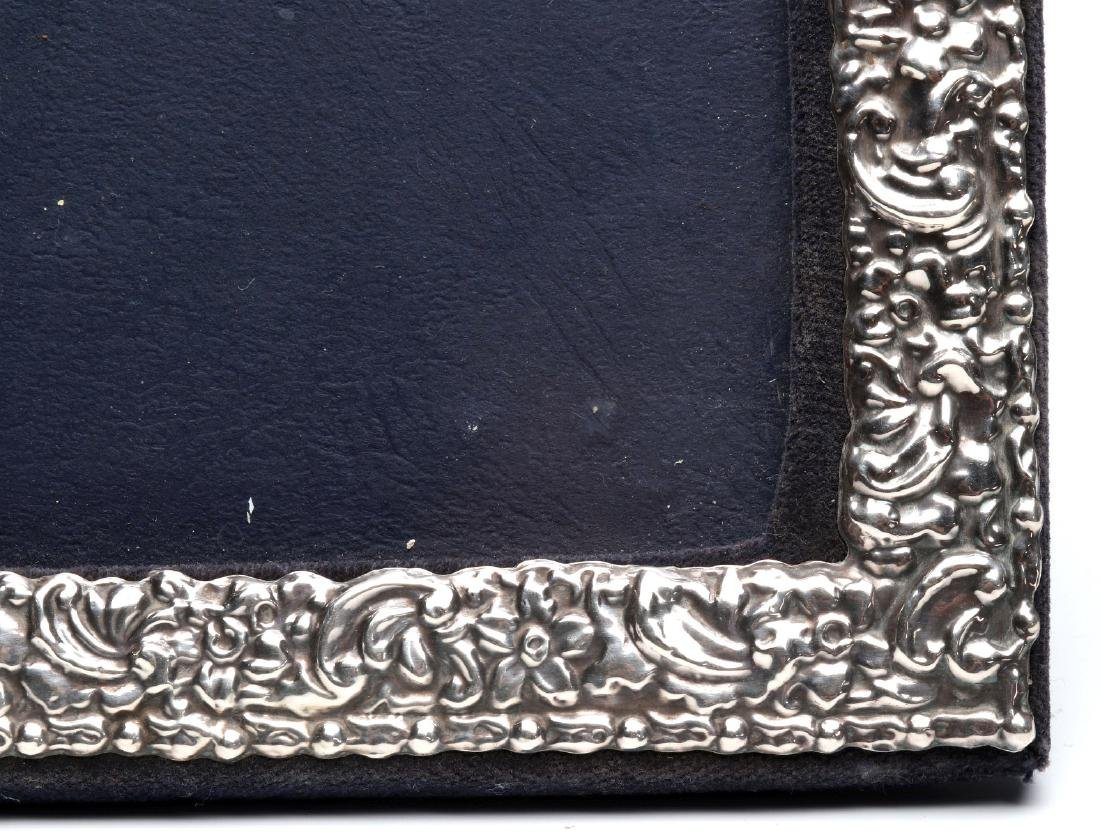 AN EARLY 20TH C.STERLING SILVER REPOUSSE FRAME - 5