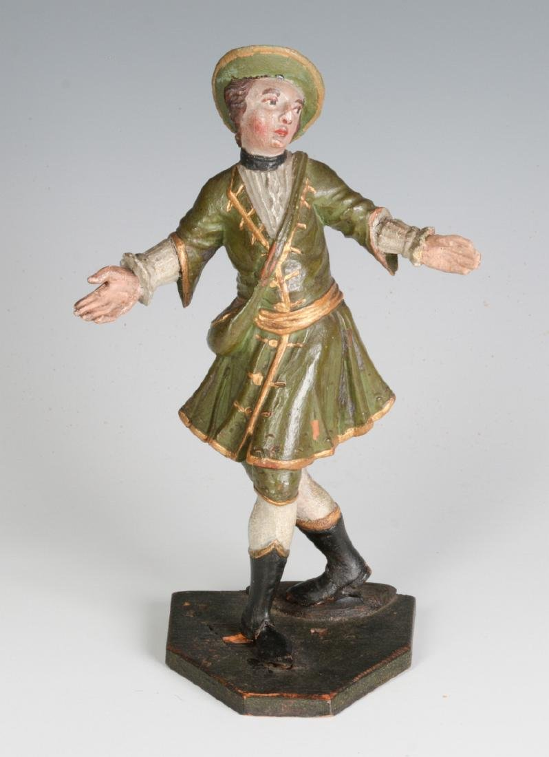 A 19TH C. CONTINENTAL CARVED AND PAINTED FIGURE