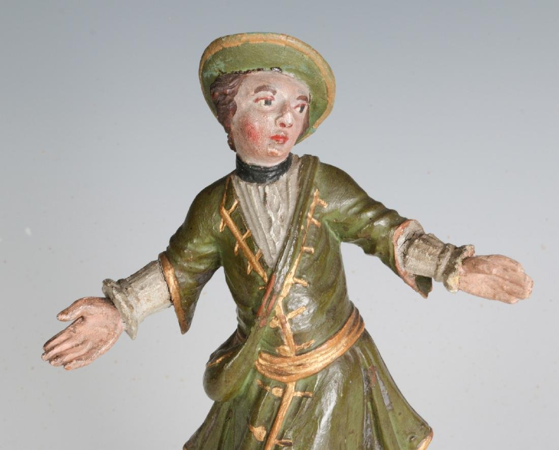 A 19TH C. CONTINENTAL CARVED AND PAINTED FIGURE - 2