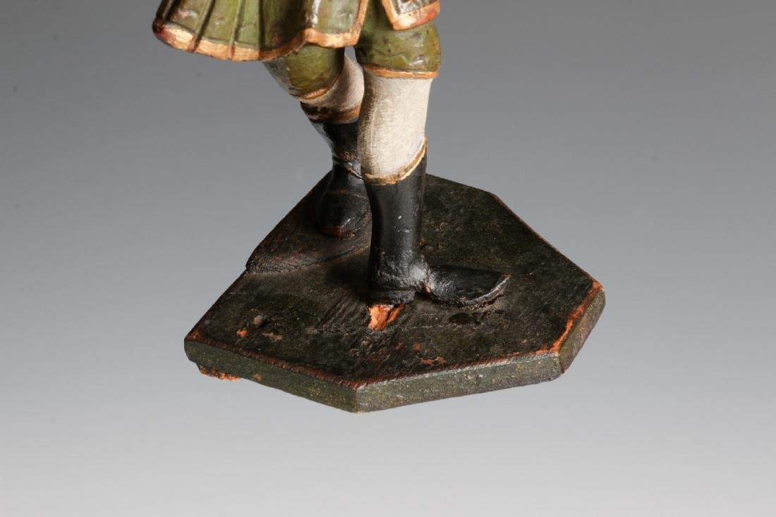 A 19TH C. CONTINENTAL CARVED AND PAINTED FIGURE - 8