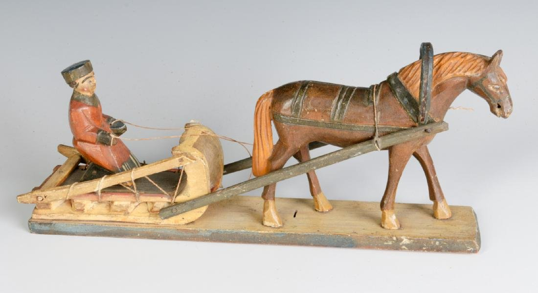 AN EARLY 20TH CENTURY EUROPEAN WOOD CARVING
