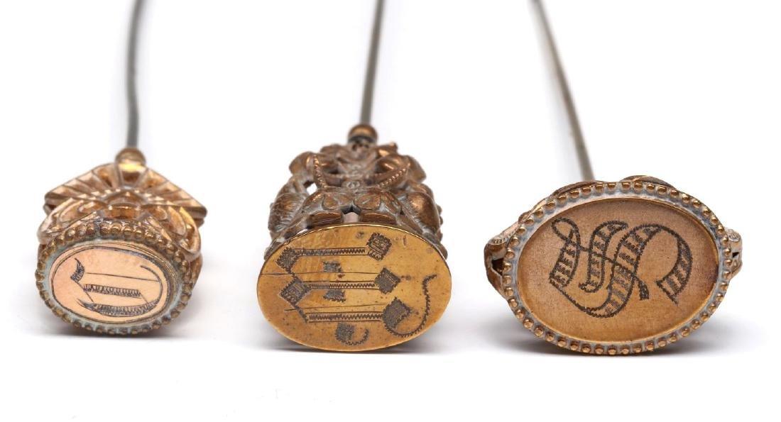 THREE GOLD FILLED VICTORIAN MONOGRAM HAT PINS