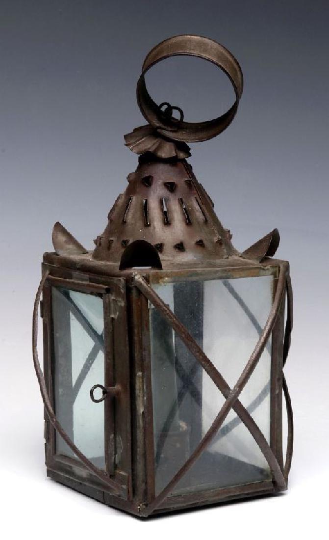 A 19TH CENTURY PIERCED TIN CANDLE LANTERN