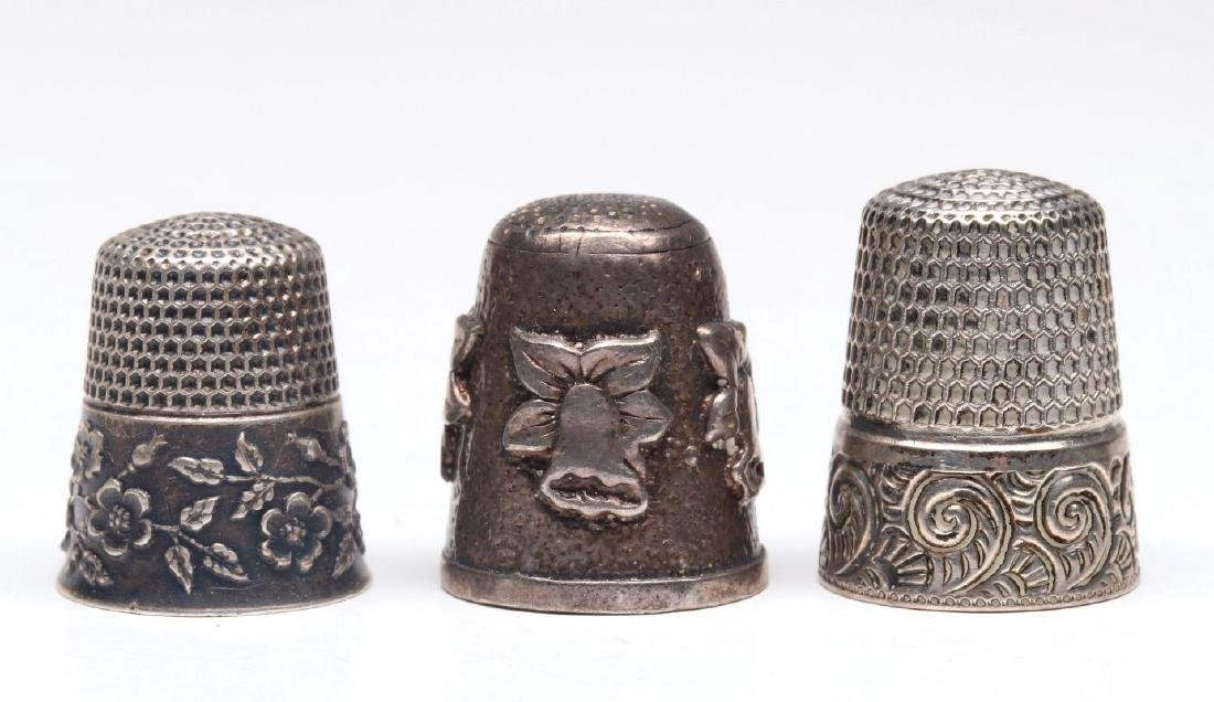 THREE ANTIQUE STERLING SILVER THIMBLES