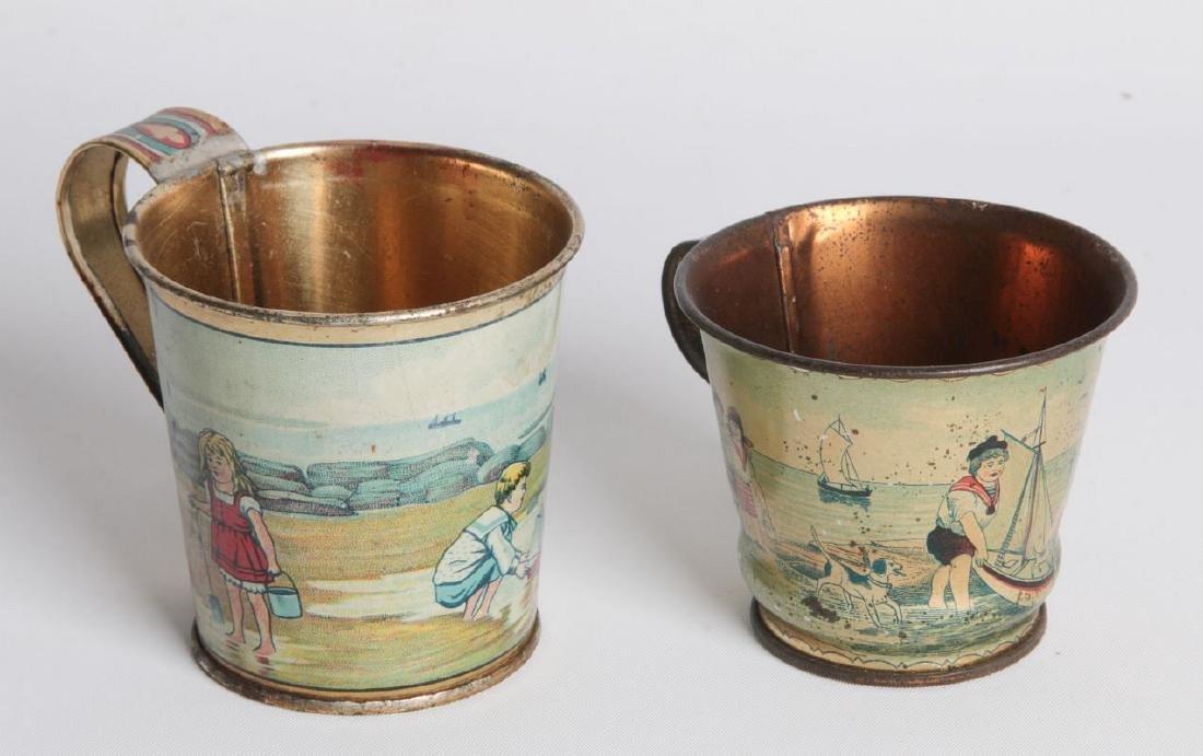A PAIR CIRCA 1900 TIN LITHO CHILD'S CUPS - 2