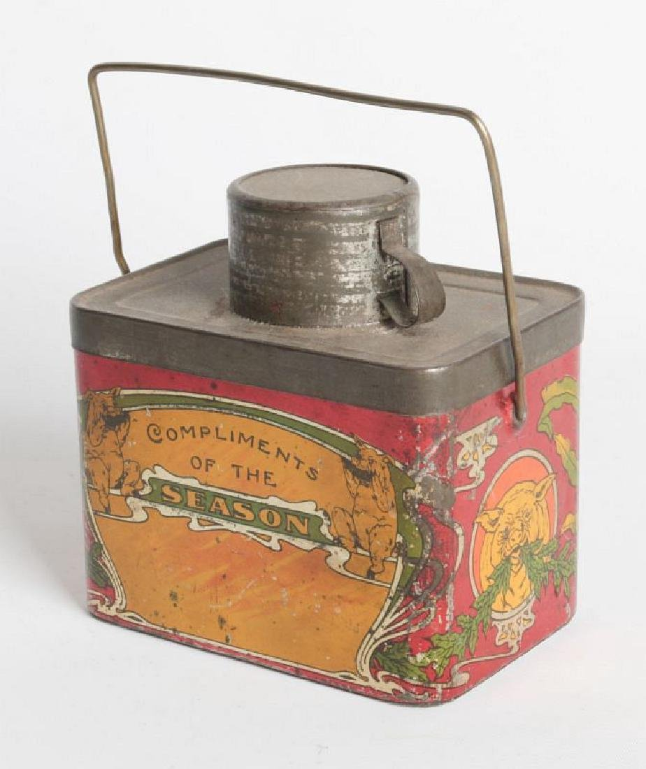 A TIN LITHO 'DINNER BUCKET' TYPE TIN WITH CUP